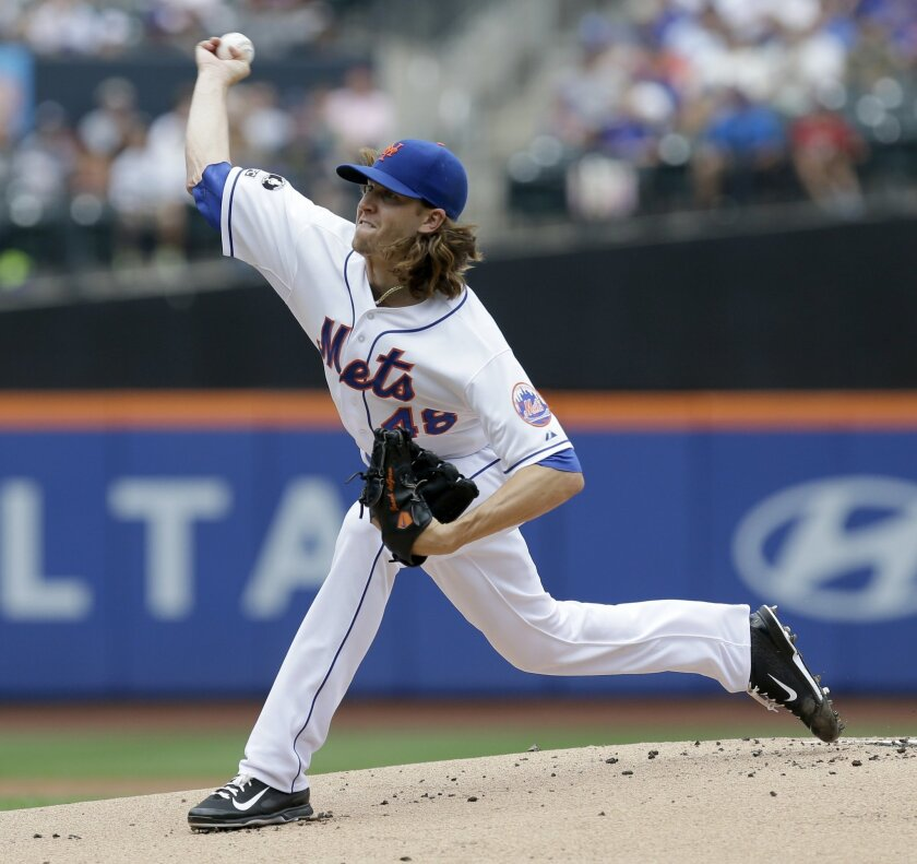 New York Mets starting pitcher Jacob deGrom throws during the first inning of the baseball game against the Miami Marlins, Sunday, July 13, 2014 in New York. (AP Photo/Seth Wenig)