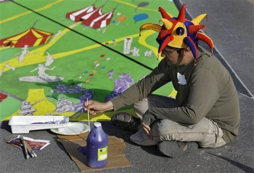 Anthony Cappetto, of New York, NY., works on his pavement art project during the Sarasota Chalk Festival Wednesday, Oct. 31, 2012, in Sarasota, Fla. The annual festival begins this week and runs through Nov. 6.(AP Photo/Chris O'Meara)