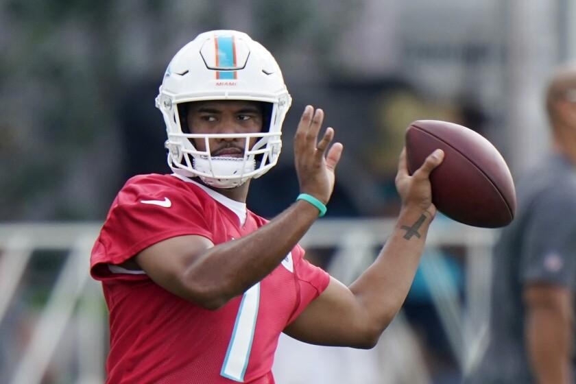 Miami Dolphins quarterback Tua Tagovailoa throws during NFL football practice, Wednesday, July 28, 2021, in Miami Gardens, Fla. (AP Photo/Wilfredo Lee)