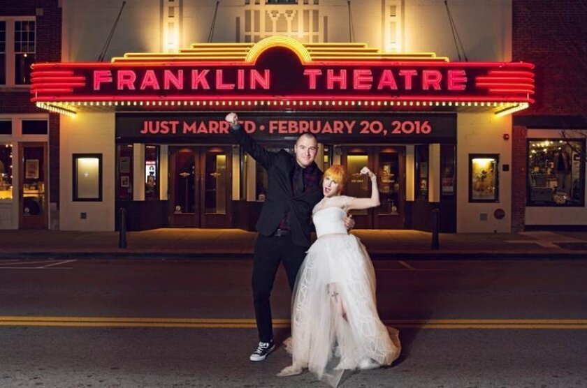 This image released by VisualReserve.com shows New Found Glory guitarist Chad Gilbert, left, and Paramore singer Hayley Williams outside of the Franklin Theatre on their wedding day, Saturday, Feb. 20, 2016 in Franklin, Tenn. (David Bean/VisualReserve.com via AP)