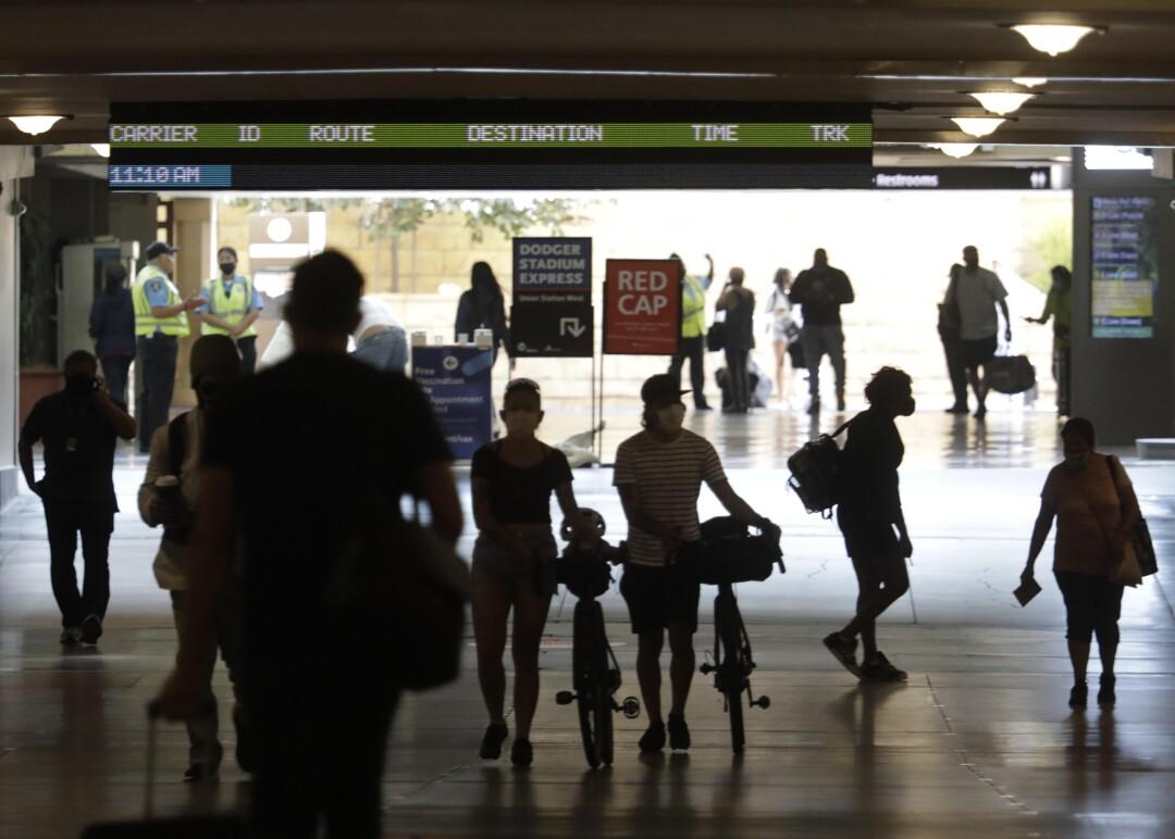 Travelers make their way through Union Station.
