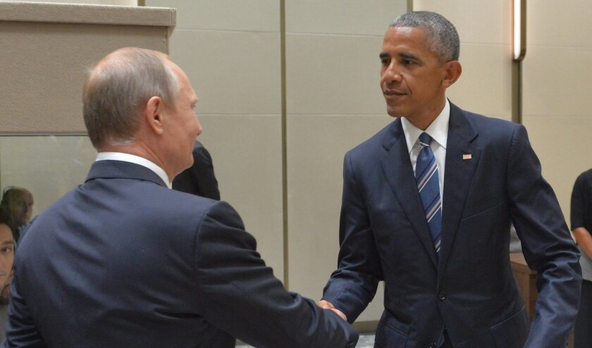 """President Obama says he warned Russian dictator Vladimir Putin to """"act responsibly and start instituting norms"""" -- and to be wary of the U.S. cyber arsenal."""