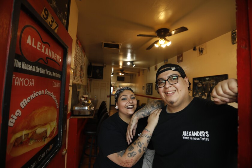 Angelina Rodriguez and husband Omar Flores, co-owners of Alexander's Hub Burritos