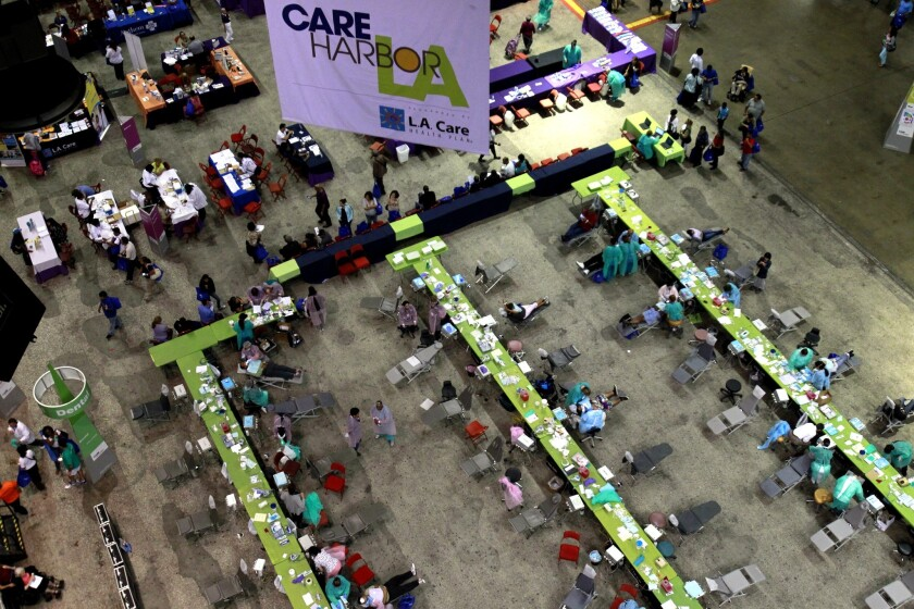 Dental work was performed on hundreds of needy patients during the first day of a four-day Care Harbor free clinic at the Los Angeles Memorial Sports Arena on Sept. 11, 2014.