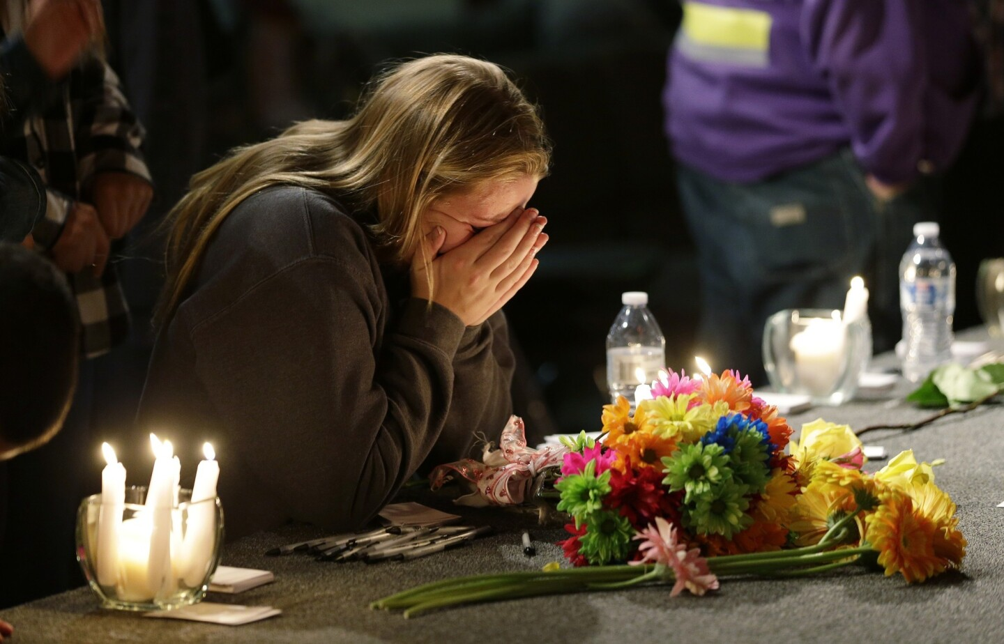 A woman grieves at a vigil at Grove Church in Marysville, Wash., held for victims of the shooting at Marysville-Pilchuck High School.