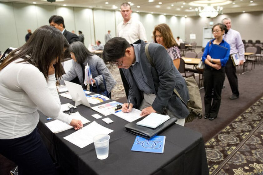 Applicants at a job fair in Concord, Calif., before the pandemic struck. On Thursday, California lawmakers on Thursday said the state is not doing enough to help those left jobless by the COVID-19 crisis.