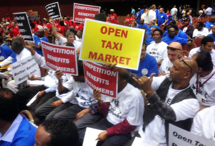 Taxicab drivers who lease their cabs and the owners of those cabs lobbied the City Council in November 2014 before the council lifted a cap on permits.