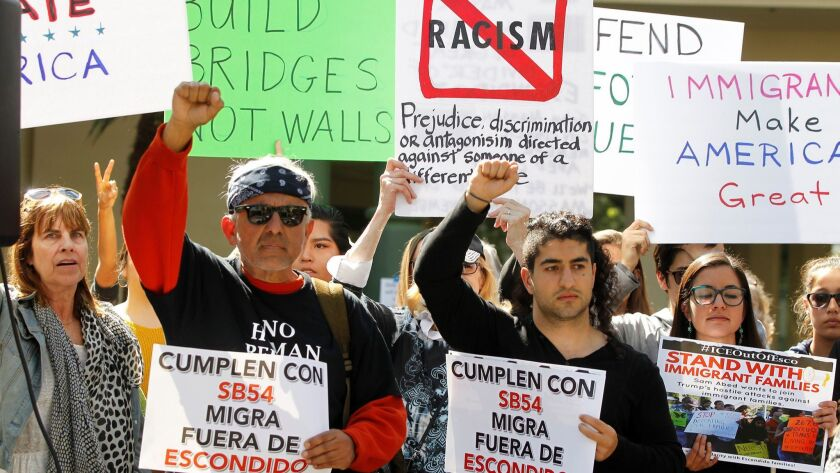 Pro-immigration supporters rally prior to Escondido City Council meeting.