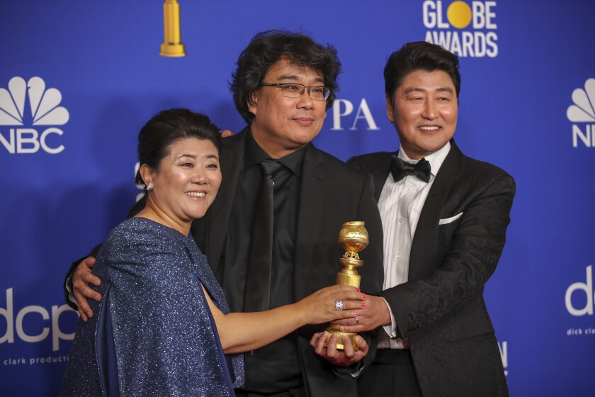 """Parasite"" actors Lee Jeong Eun and Song Kang Ho flank director Bong Joon Ho at the Golden Globe Awards."