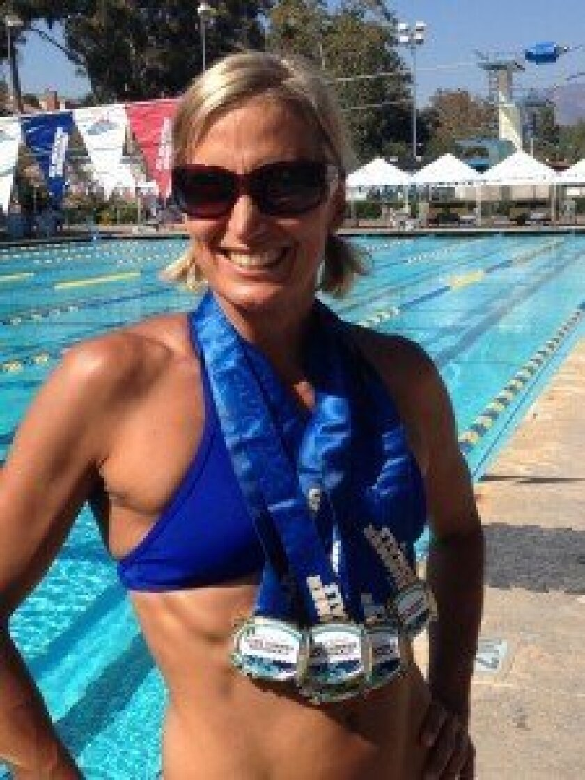 Carmel Valley Middle School PE teacher Jasmine Stiles earned eight top 10 medals at the 2013 Marriott U.S. Masters Swimming Summer Nationals in Mission Viejo. Courtesy photo