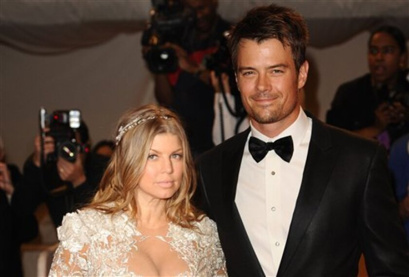 FILE - This is a Monday May 2, 2011 file photo of singer Fergie and her husband, actor Josh Duhamel, arrive at the Metropolitan Museum of Art Costume Institute gala, Monday, May 2, 2011 in New York. Actor Josh Duhamel and his wife, Black Eyed Peas singer Fergie, have already started doing their hom