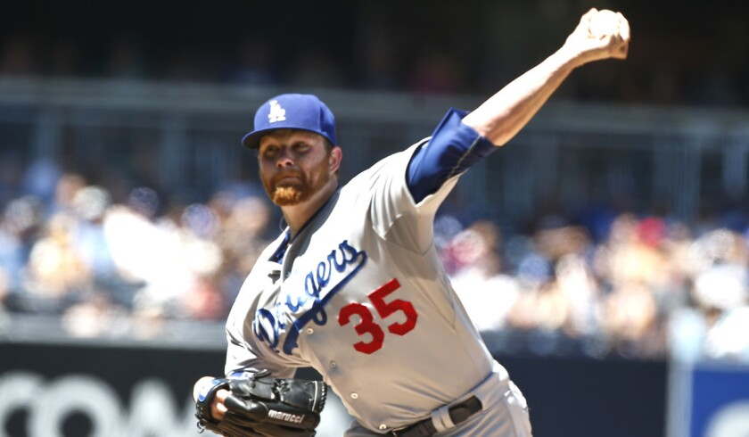 Los Angeles Dodgers starting pitcher Brett Anderson works against the San Diego Padres during a game on Sunday.