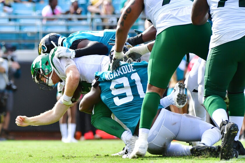 New York Jets quarterback Sam Darnold is sacked by Jacksonville Jaguars defensive end Yannick Ngakoue during Sunday's game.
