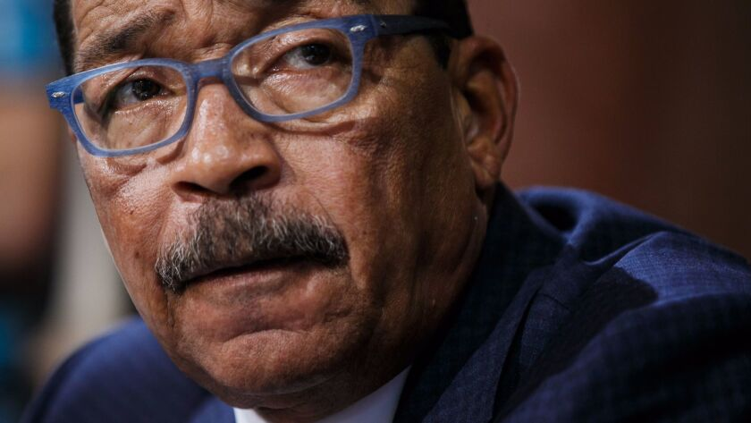 Los Angeles City Council President Herb Wesson, seen at a City Hall hearing last month, sought to reassure marijuana business owners Monday that he would find a way to address their concerns about proposed regulations.