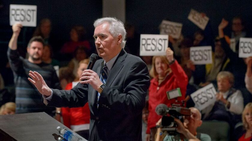 "Congressman Tom McClintock, R-Calif., faced a rowdy crowd at the packed town hall meeting at the Tower Theatre in Roseville, Calif., Saturday, Feb. 4, 2017. McClintock had to be escorted by police as protesters followed him shouting ""Shame on you!"""