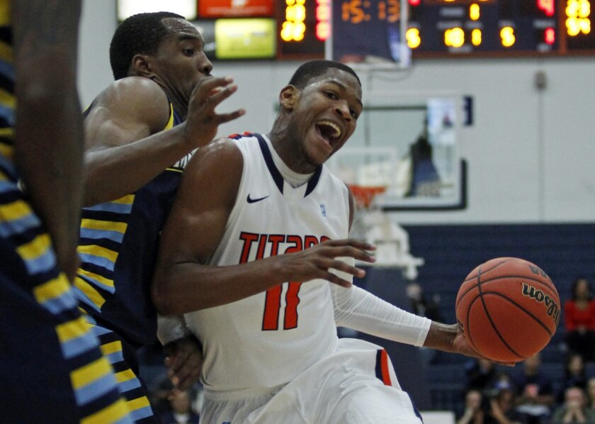 Cal State Fullerton guard Josh Gentry, right, collides into Marquette guard Derrick Wilson, left, defending in the first half of an NCAA college basketball game at the Wooden Legacy tournament Thursday, Nov. 28, 2013, in Fullerton, Calif. (AP Photo/Alex Gallardo)