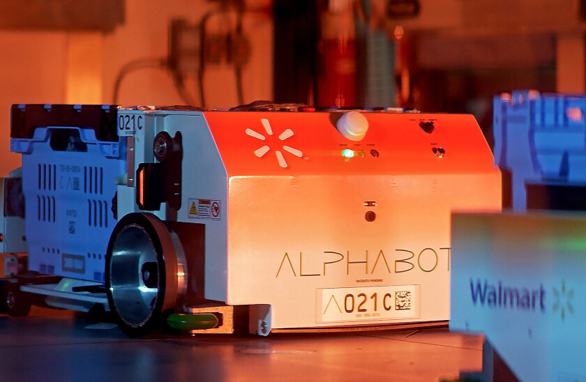 Walmart's Alphabot, an automated, 20,000-square-foot warehouse that could make its grocery pickup service faster and more efficient.
