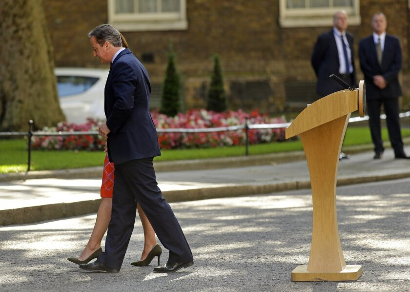 FILE - In this Friday, June 24, 2016 file photo, Britain's Prime Minister David Cameron and his wife Samantha walk back into 10 Downing Street, London, after speaking to the media. Cameron says he will resign by the time of the party conference in the fall after Britain voted to leave the European