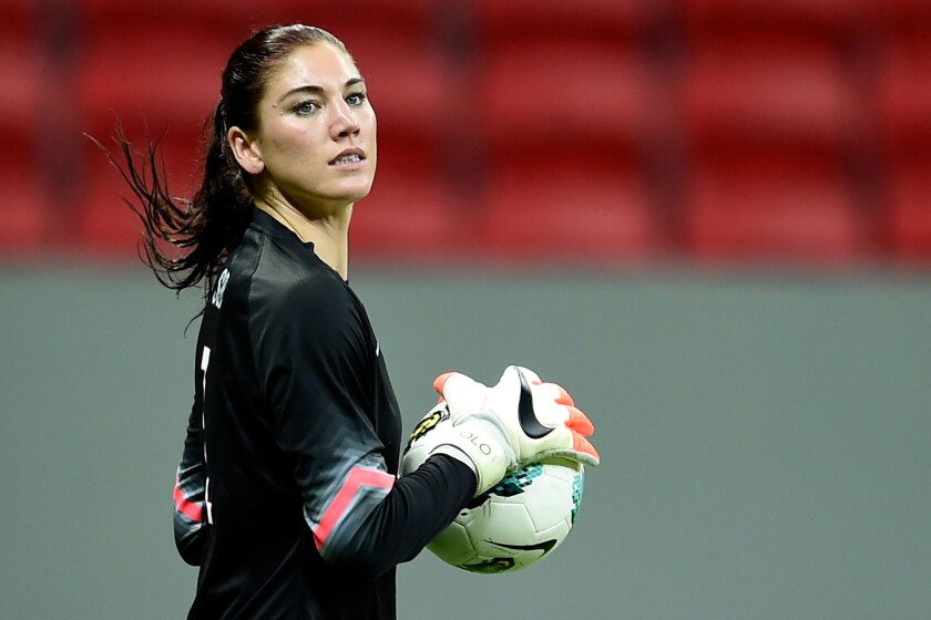 U.S. national team goalkeeper Hope Solo holds the ball during a match against China on Dec. 10 in Brazil.