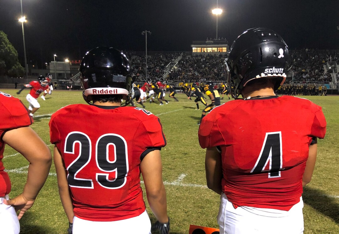 Prohibited players watch from the sidelines during their annual rivalry game against San Pedro.