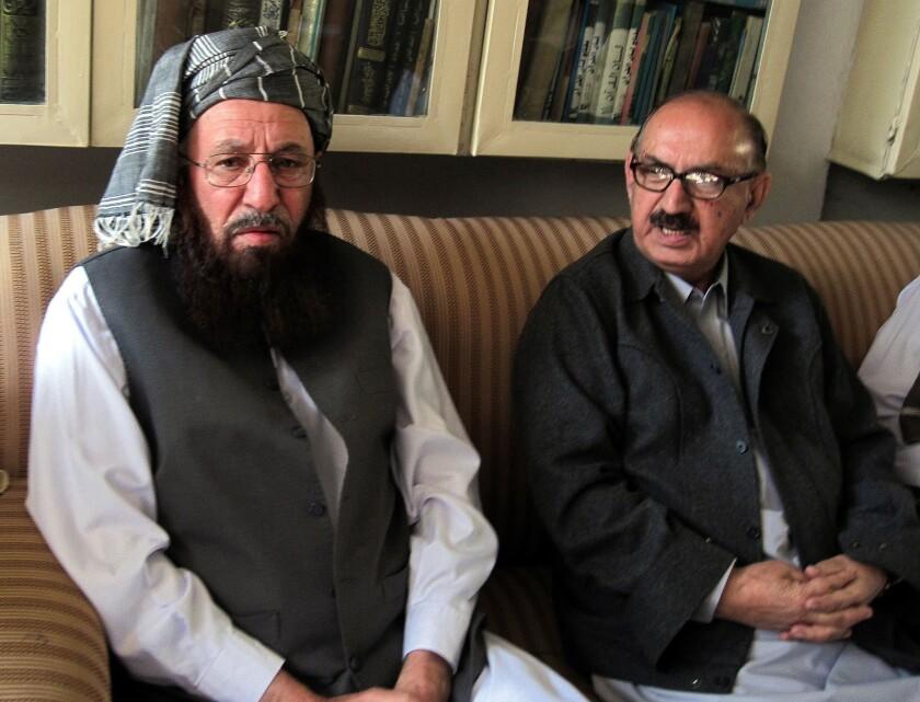Pakistani Taliban representative Maulana Sami ul-Haq, left, meets with the special assistant to Pakistan's prime minister, Irfan Siddiqui, during peace talks outside Peshawar.