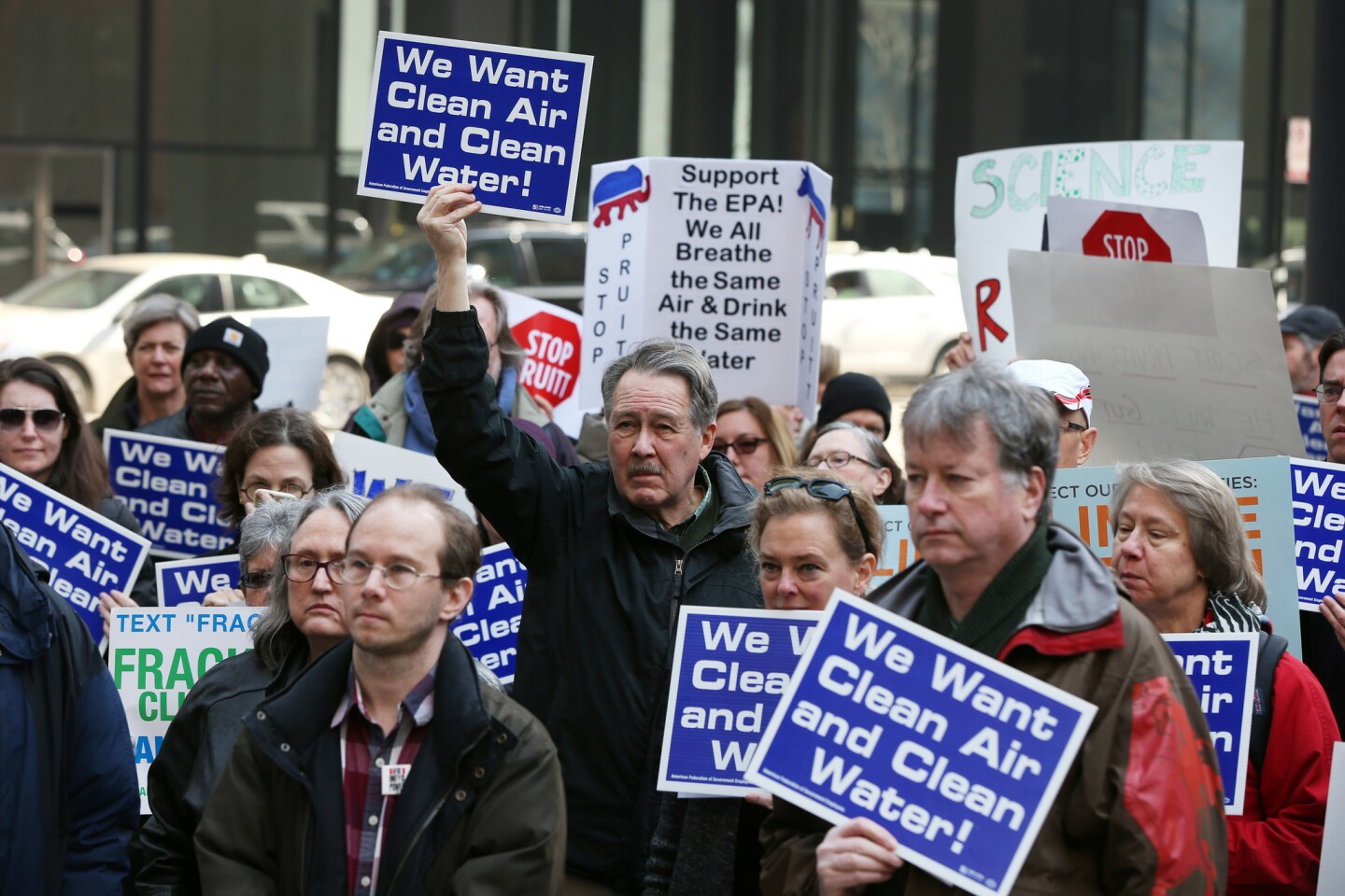 Larry Hoellwarth, center, joins Environmental Protection Agency staffers rallying in Federal Plaza in Chicago on Monday, Feb. 6, 2017, against the nomination of Scott Pruitt as agency head.