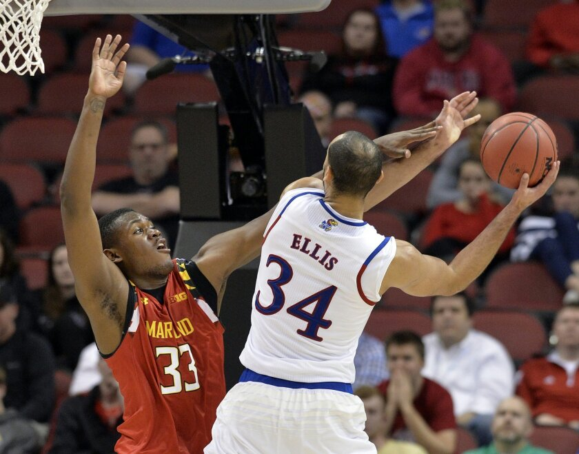 Maryland center Diamond Stone (33) attempts to block the shot of Kansas forward Perry Ellis (34) during the second half of an NCAA college basketball game in the regional semifinals of the men's NCAA Tournament, in Louisville, Ky., Thursday, March 24, 2016. Kansas won 79-63, (AP Photo/Timothy D. Easley)