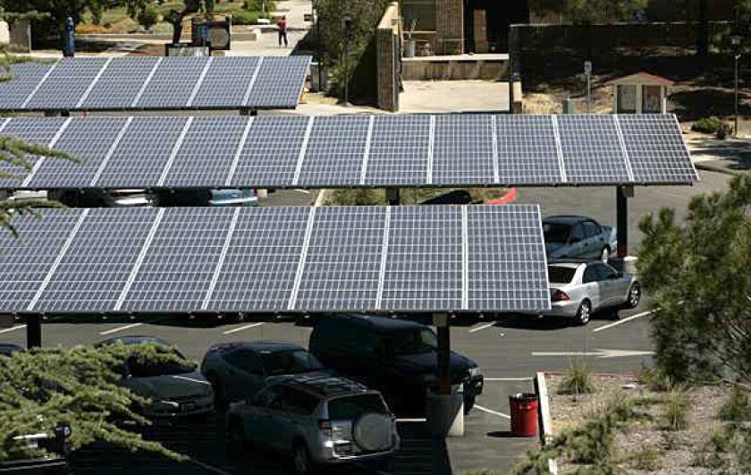 These solar panels at Pierce College in Woodland Hills are among the district's green energy projects that were built. But millions of dollars were poured into designs for installations that proved so impractical or unpopular that they were scrapped.