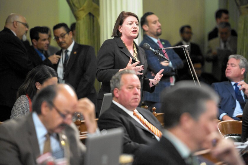 Assembly Speaker Toni Atkins, center, addresses fellow lawmakers during a discussion on a climate change bill hours before the end of the 2015 legislative session.