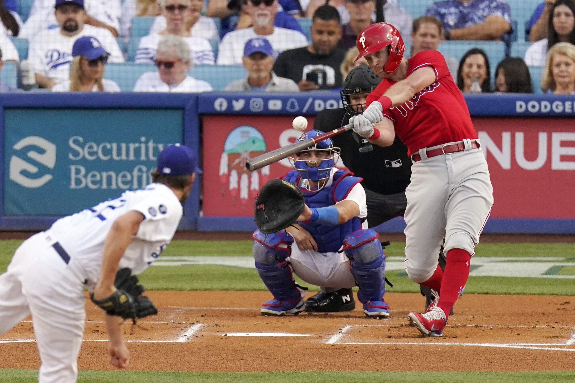 Philadelphia's Rhys Hoskins hits a solo home run off Dodgers starting pitcher Clayton Kershaw.