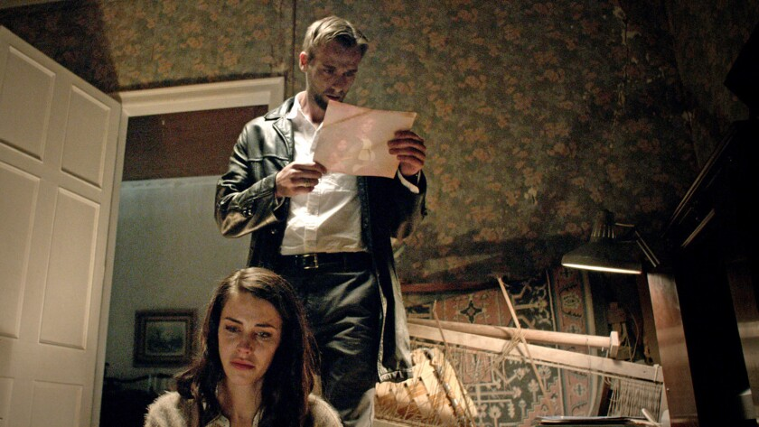 """Jessica Lowndes and Joe Anderson in the movie """"Abattoir."""""""