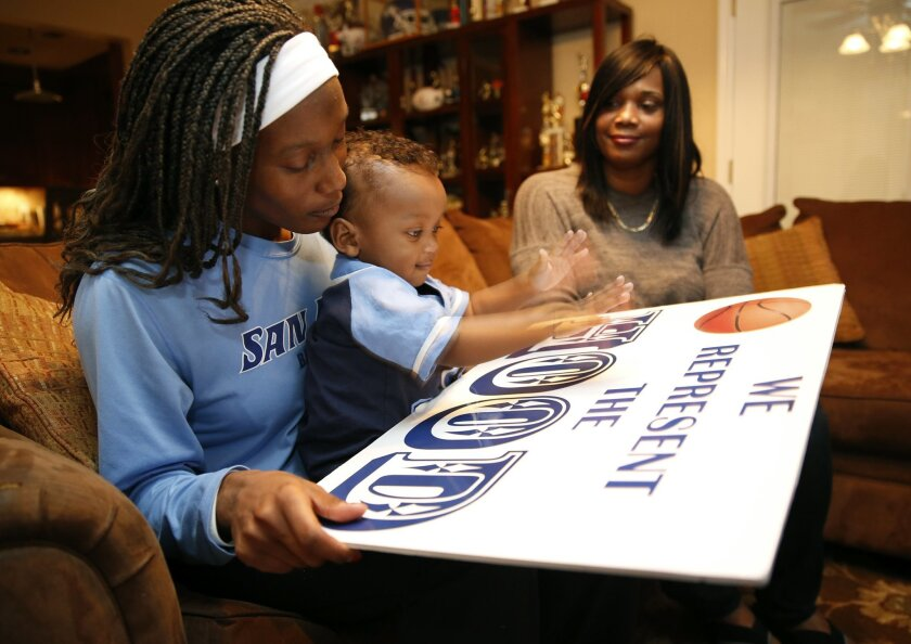 January 14, 2015. San Diego, CA. ..Maya Hood, her son Elijah, 13 months, and mom, Karen, are photographed in their home on Westchester Ave. in San Diego. . Nancee E. Lewis / Nancee Lewis Photography. No other reproduction allow with out consent of licensor. Permission for reproduction required...