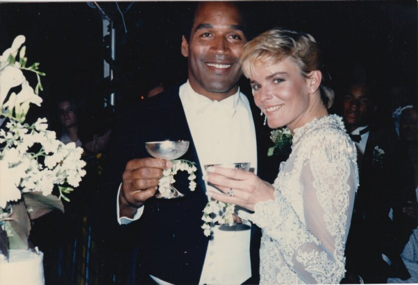 """An image from """"O.J.: Made In America"""" of O.J. Simpson, with bride Nicole Brown Simpson."""