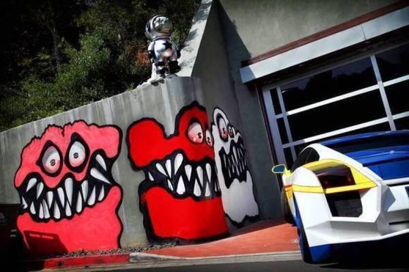 Chris Brown's artwork outside his home.