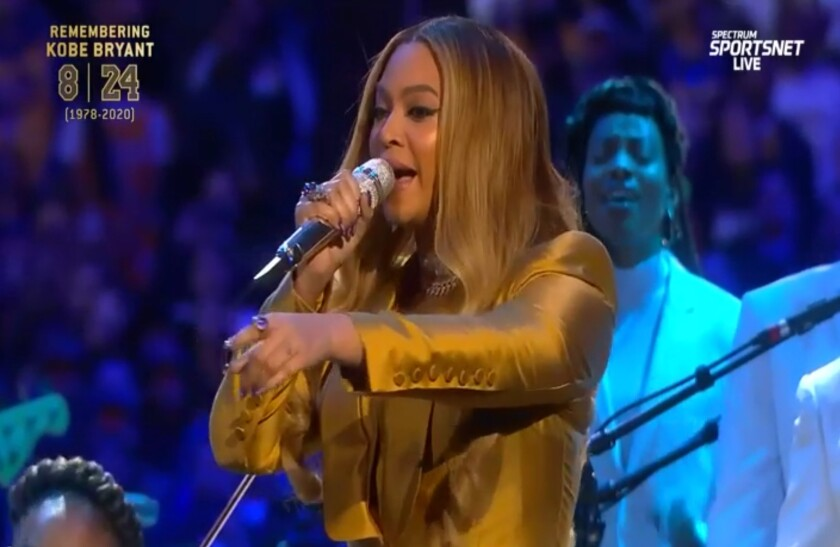A screenshot of Beyoncé performing during the 'Celebration of Like' at Staples.