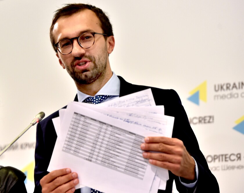 Ukrainian lawmaker Sergei Leshchenko holds pages purportedly from a ledger showing payments to Paul Manafort by the party of former Ukrainian President Viktor Yanukovich during a news conference in Kyiv in 2016.
