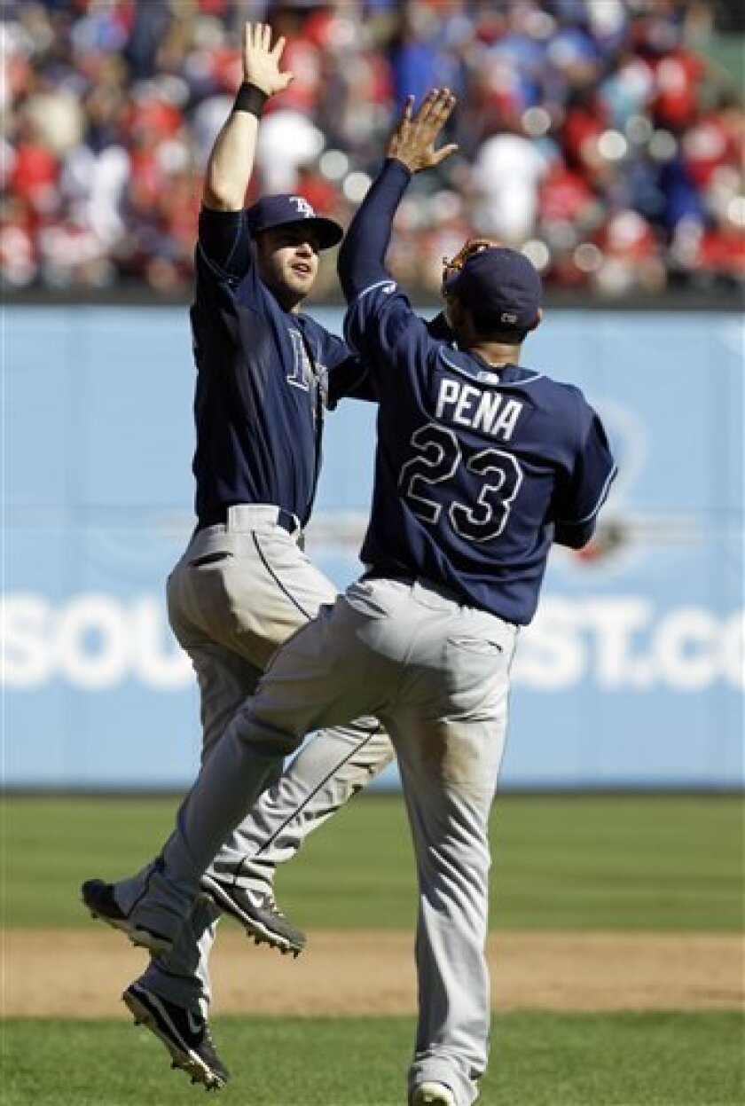 Tampa Bay Rays' Evan Longoria, left, and Carlos Pena celebrate after the Rays defeated the Texas Rangers 5-2 in Game 4 of baseball's American League Division Series on Sunday, Oct. 10, 2010, in Arlington, Texas. (AP Photo/David J. Phillip)