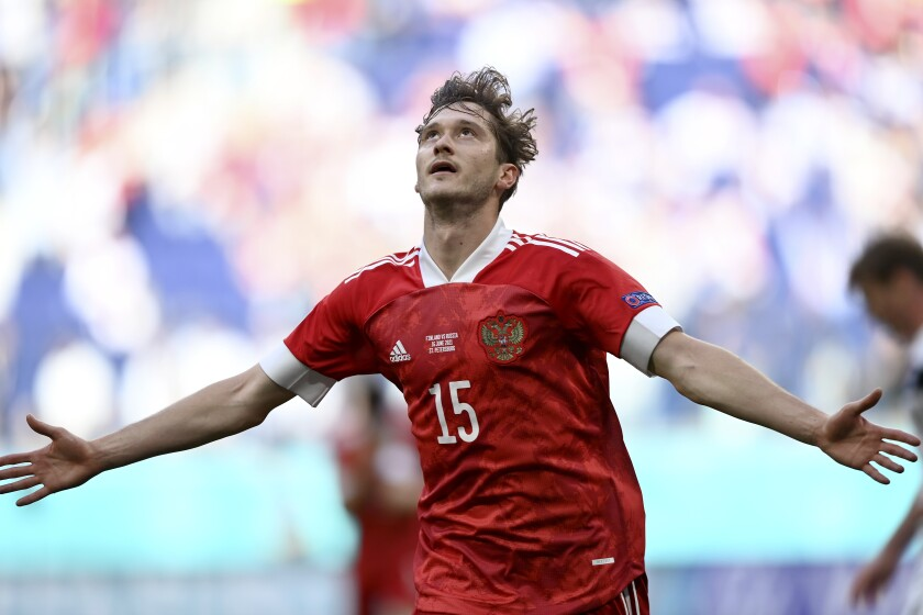 Russia's Aleksei Miranchuk celebrates after scoring the opening goal during the Euro 2020 soccer championship group B match between Finland and Russia at the Gazprom Arena stadium in St. Petersburg, Russia, Wednesday, June 16, 2021. (AP Photo/Kirill Kudryavtsev, Pool)