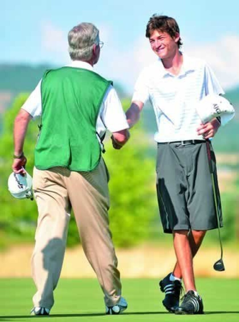 Perry Cohen, 17, shakes his caddy's hand after an impressive effort at the U.s. Amateur Qualifying game in Oregon. Courtesy