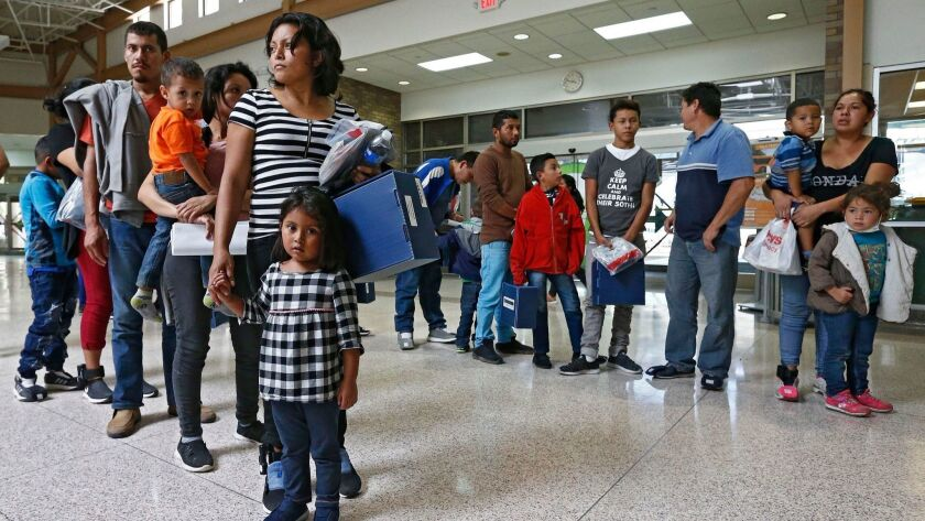 Migrant families are processed at the Central Bus Station before being taken to Catholic Charities before being removed in McAllen, Texas.