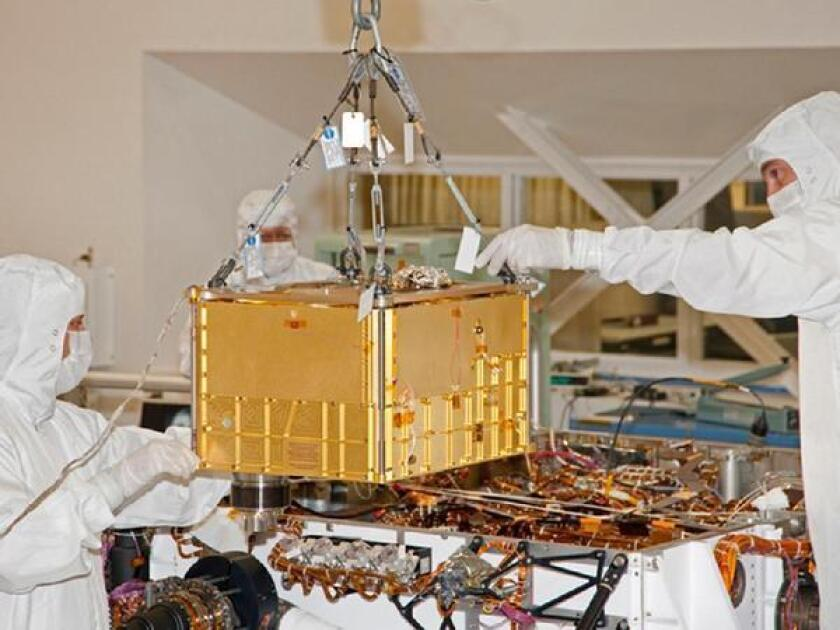 """A discovery said to be """"one for the history books"""" has been made by SAM, a suite of science instruments aboard NASA's Curiosity. Here, workers inside a clean room at the Jet Propulsion Laboratory in La Canada-Flintridge prepare to install SAM into the rover."""