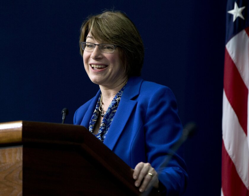 """FILE - In this Feb. 18, 2015 file photo, Sen. Amy Klobuchar, D-Minn. speaks during the White House Summit on Countering Violent Extremism in Washington. Henry and Holt Company announced Thursday that Klobuchar is working on an """"inspiring, witty"""" book about her life and how to set aside """"partisan flame throwing"""" in politics. The book is called """"The Senator Next Door"""" and is scheduled for Aug. 25. (AP Photo/Carolyn Kaster, File)"""