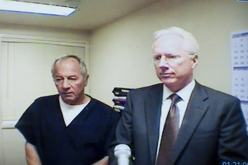 Defense attorney Paul Pfingst stands with his client, Timothy Danielson, during a televised arraignment hearing in Superior Court in El Cajon. Danielson is charged with his ex-wife's murder.
