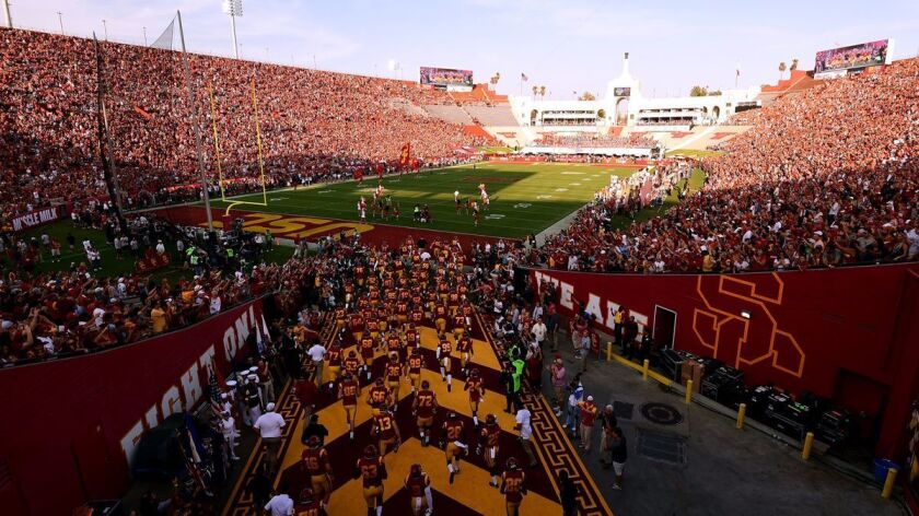 USC takes the field before their game against Texas at the Coliseum on Saturday. The game was a sell