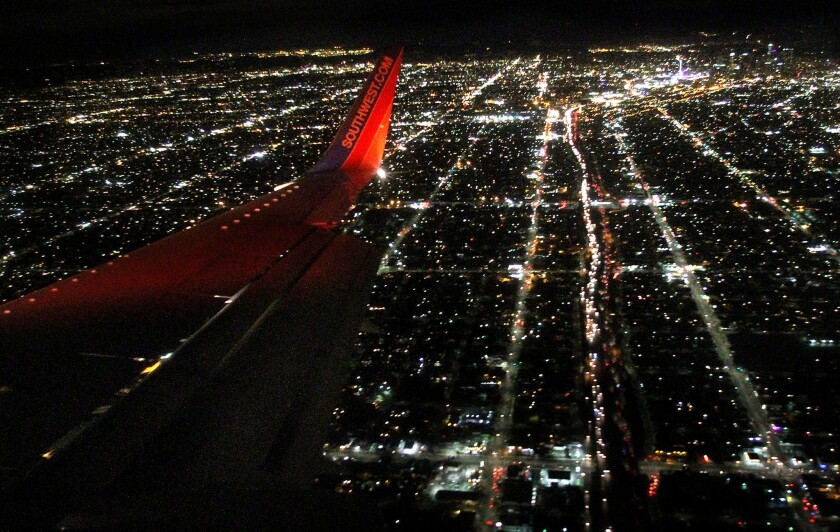 Southwest has barred two Muslim passengers from flights in recent days after they were thought to be acting strangely. Here, a Southwest jet approaches LAX in 2013.