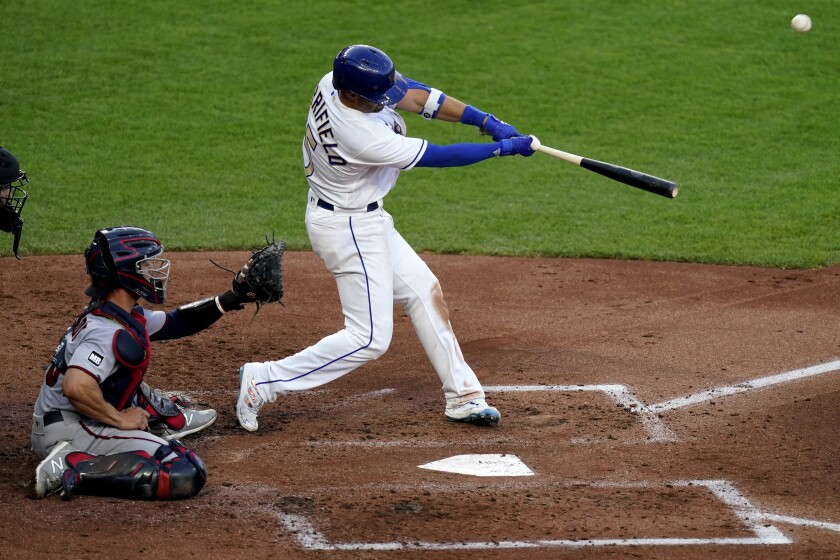 Kansas City Royals' Whit Merrifield hits a three-run home run during the first inning of a baseball game against the Minnesota Twins Friday, June 4, 2021, in Kansas City, Mo. (AP Photo/Charlie Riedel)