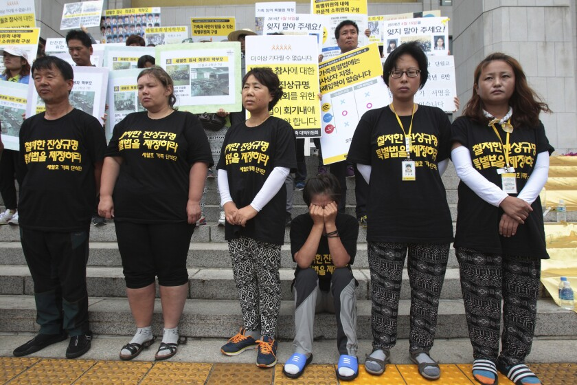 Family members of the victims of the sunken ferry Sewol stage a rally in front of the National Assembly in Seoul on July 22, demanding that lawmakers authorize an investigation into the cause of the tragedy.