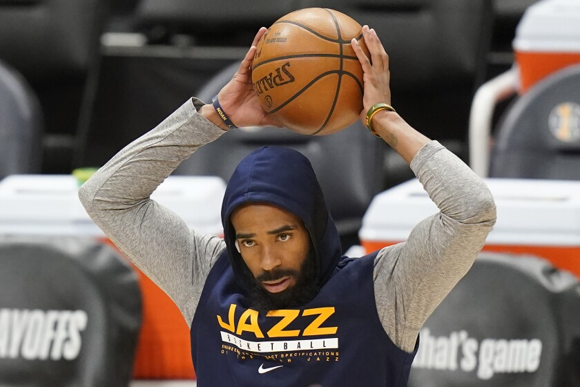 Utah Jazz guard Mike Conley stands on the court.