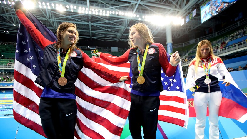 American swimmer Lilly King, center, not only won gold but helped serve up some patriotism with her harsh words for Russian rival Yulia Efimova, right, the silver medalist.