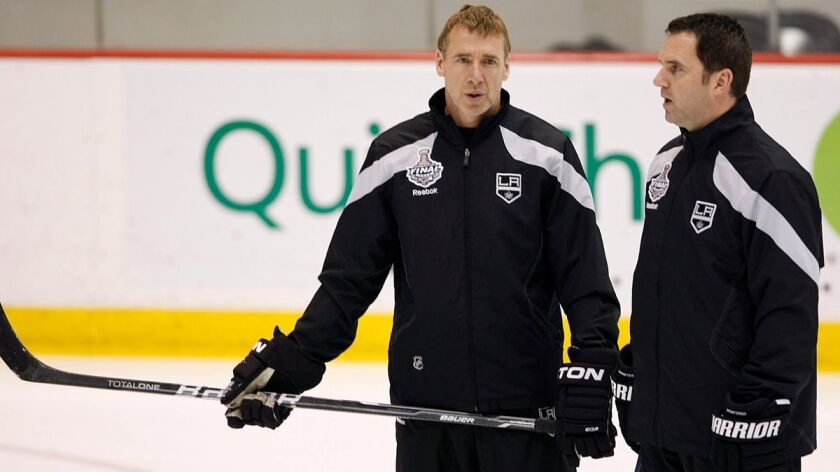 Kings goalie coach Bill Ranford, right, pictured in 2012 with Kings assistant Bernie Nicholls, said nearly 1,000 people expressed interest in the opening for an emergency goaltender. The Kings auditioned about 35 hopefuls Wednesday.